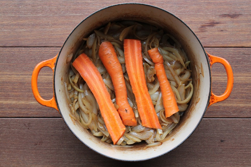 Into the dutch oven goes almost caramelized onions, a few carrots...