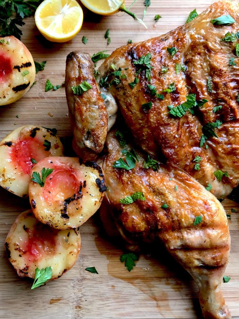 grilled chicken under a brick