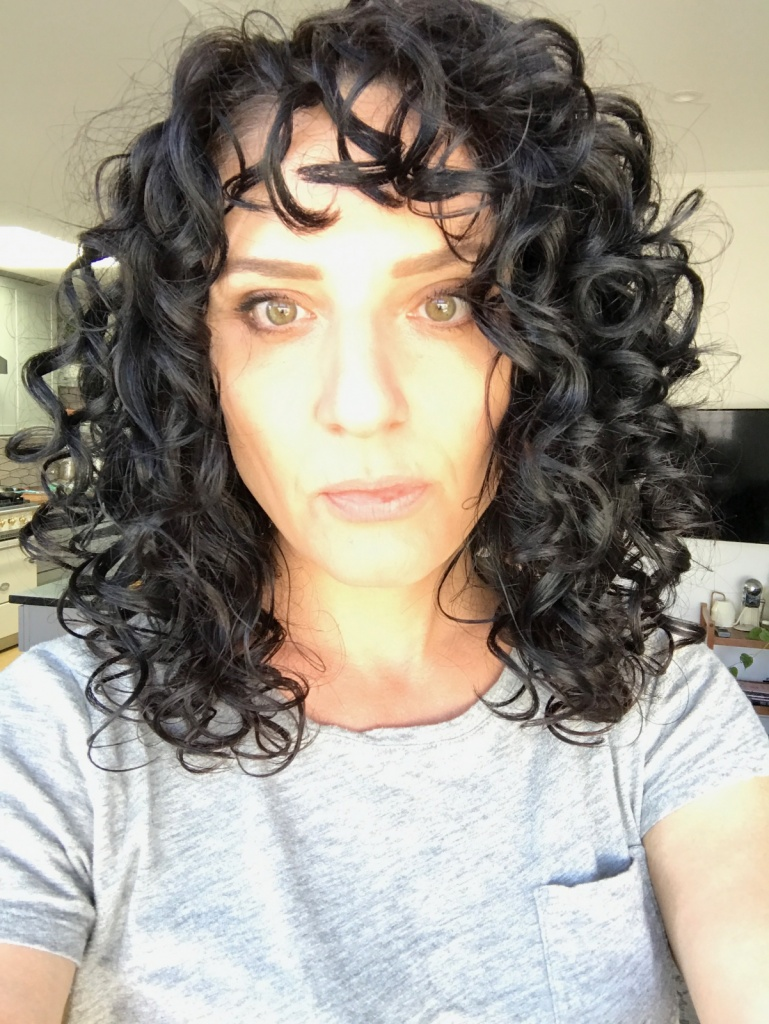 embracing my curly hair and why I don't use the curly girl method