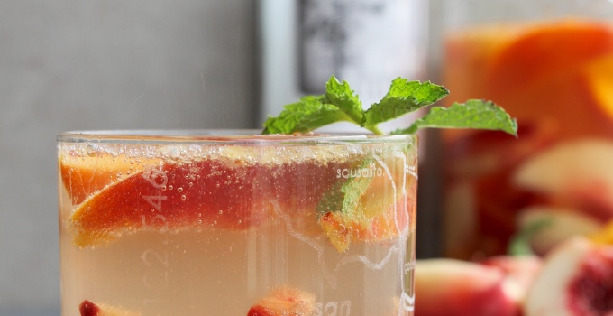 Light and summery white wine sangria with stone fruit and whiskey