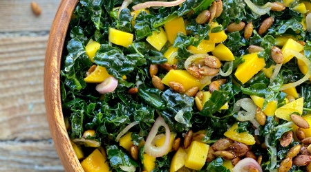 easy kale salad with mango, spiced pepitas & pickled shallots